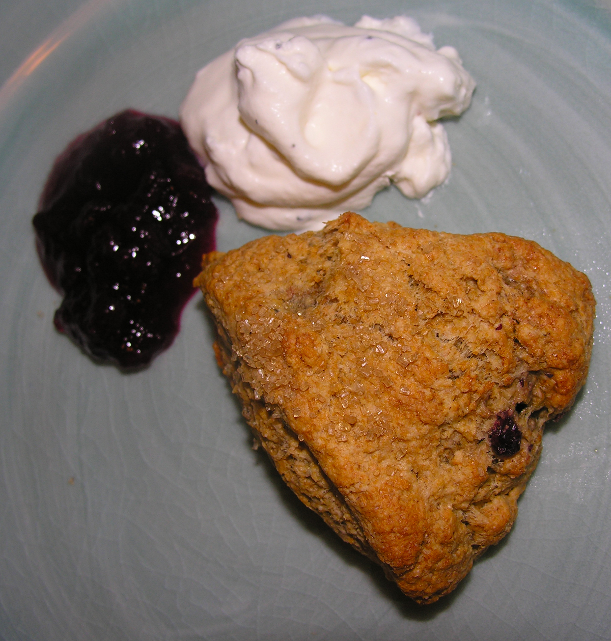 Whole grain scones with green cardamom and lingonberry