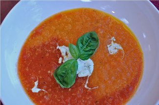 Roasted Carrot & Tomato Soup with a Topping of Basil Infused Creme Fraiche