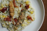Corn Risotto garnished with Bacon &amp; Anchovy Sage Leaf Bite