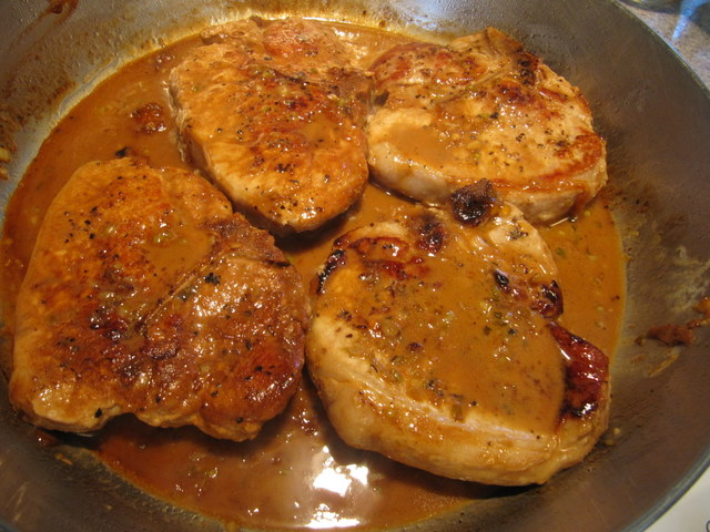 Pork Chops with Flaming Apricot Bourbon Sauce