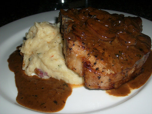Grilled Pork Chop with Brandy Mushroom Sauce
