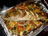 Whole Fish Roasted with a Medley of Vegetables.