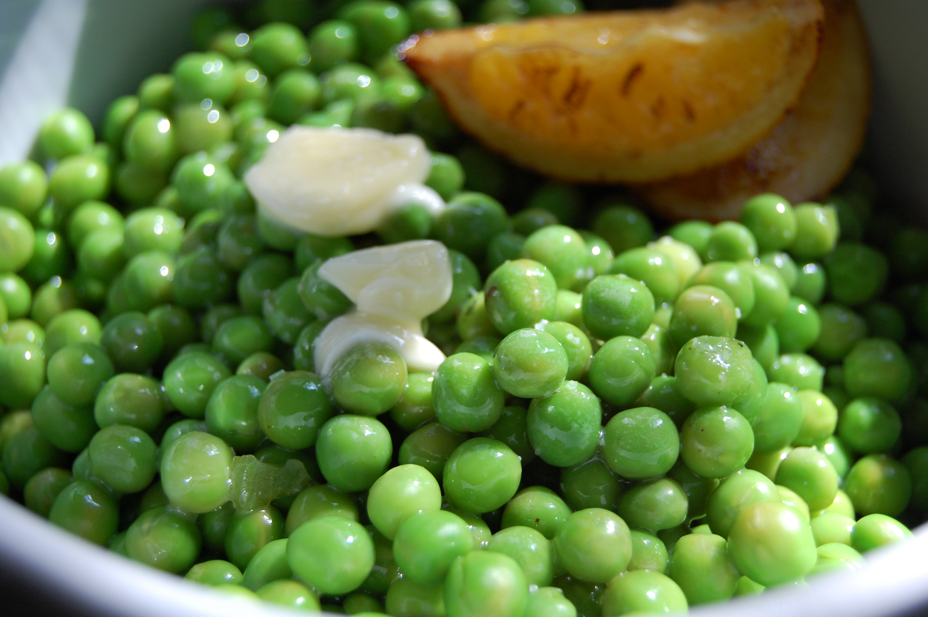 Fresh Peas Dressed with Grilled Meyer Lemon  Oil and Butter