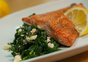 Pan Seared Salmon atop spinach salad
