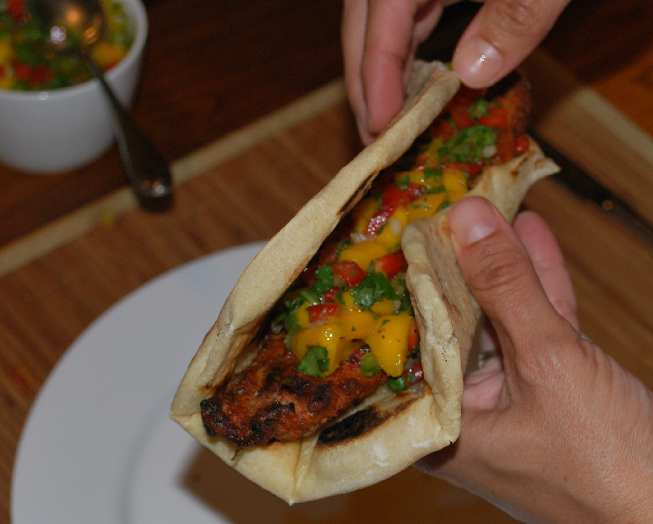 Hot smoked paprika pork with mango salsa in flat bread