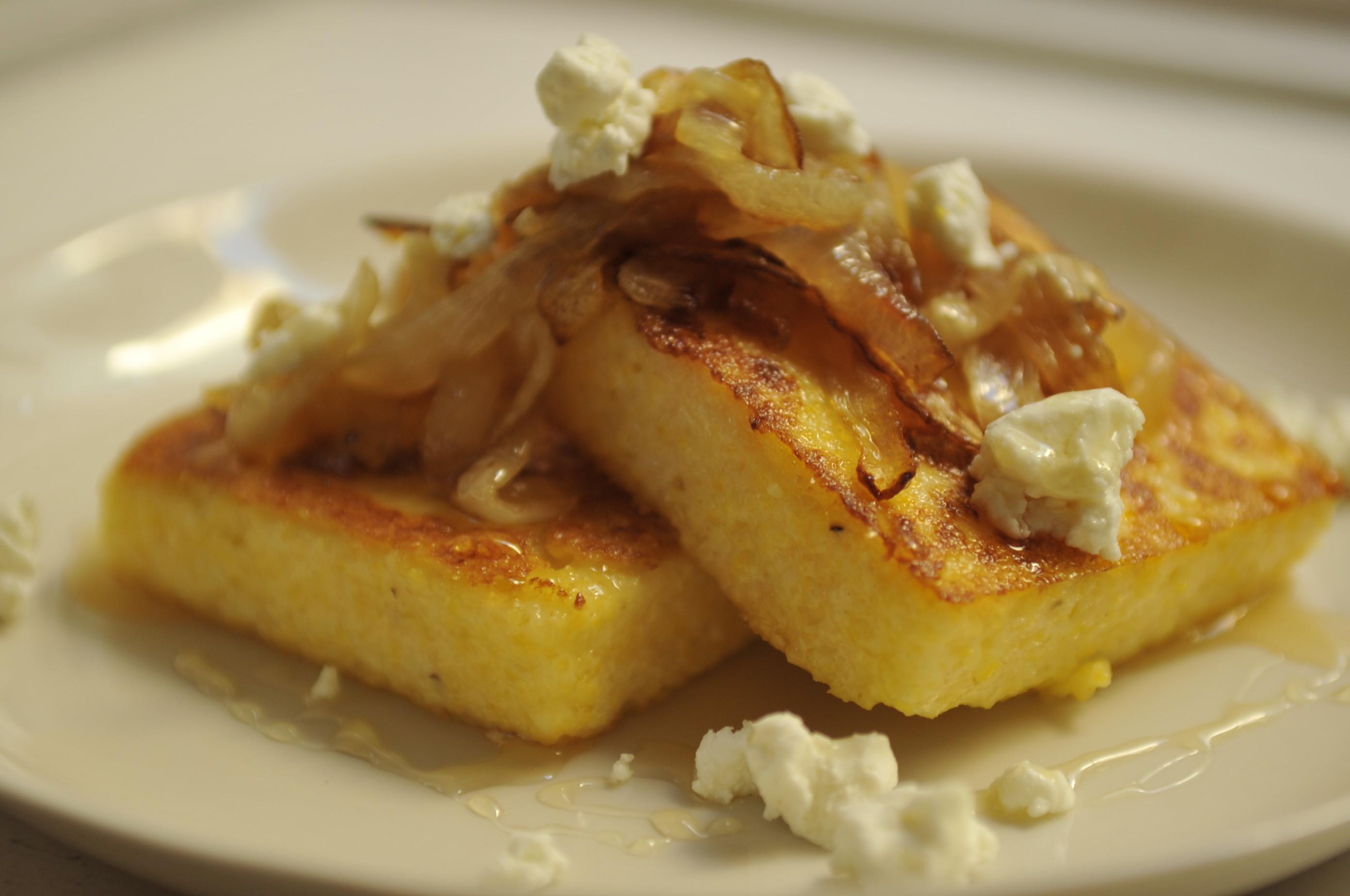 Griddled Polenta Cakes with Caramelized Onions, Goat Cheese, and Honey ...