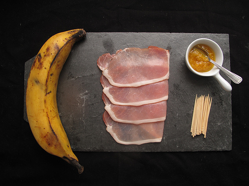 Bacon-rolled Plantains with Yellow chilli Sauce