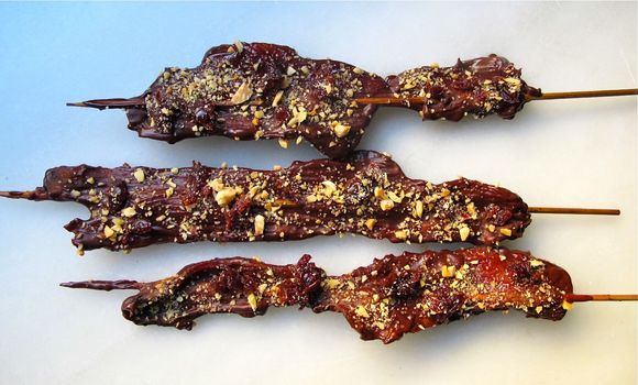 Chocolate_covered_bacon_with_cherries_and_marcona_almonds_1