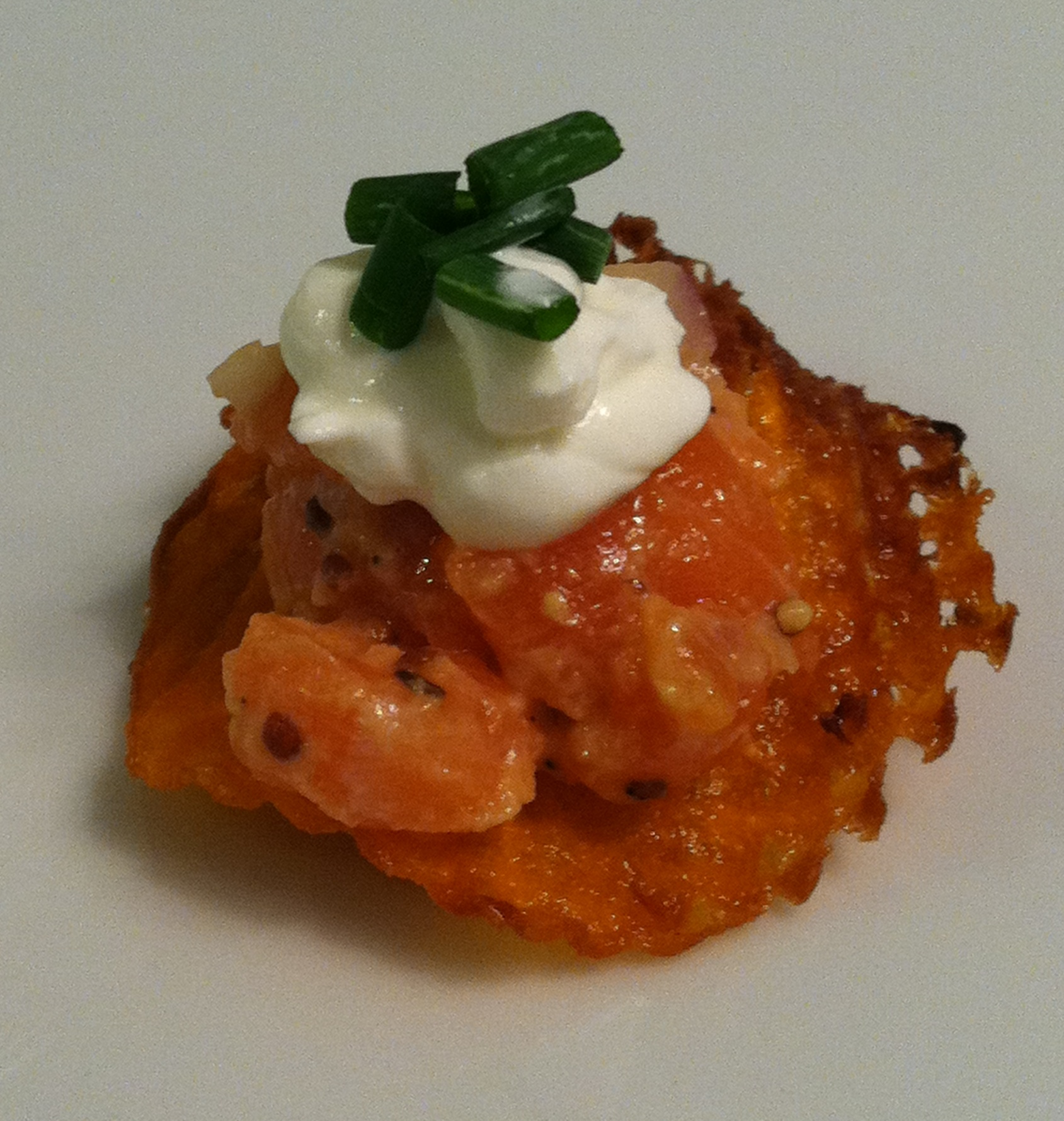 Salmon tartar on sweet potato waffle chip