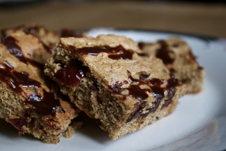 Gooey cardamom, dark chocolate and cranberry blondies