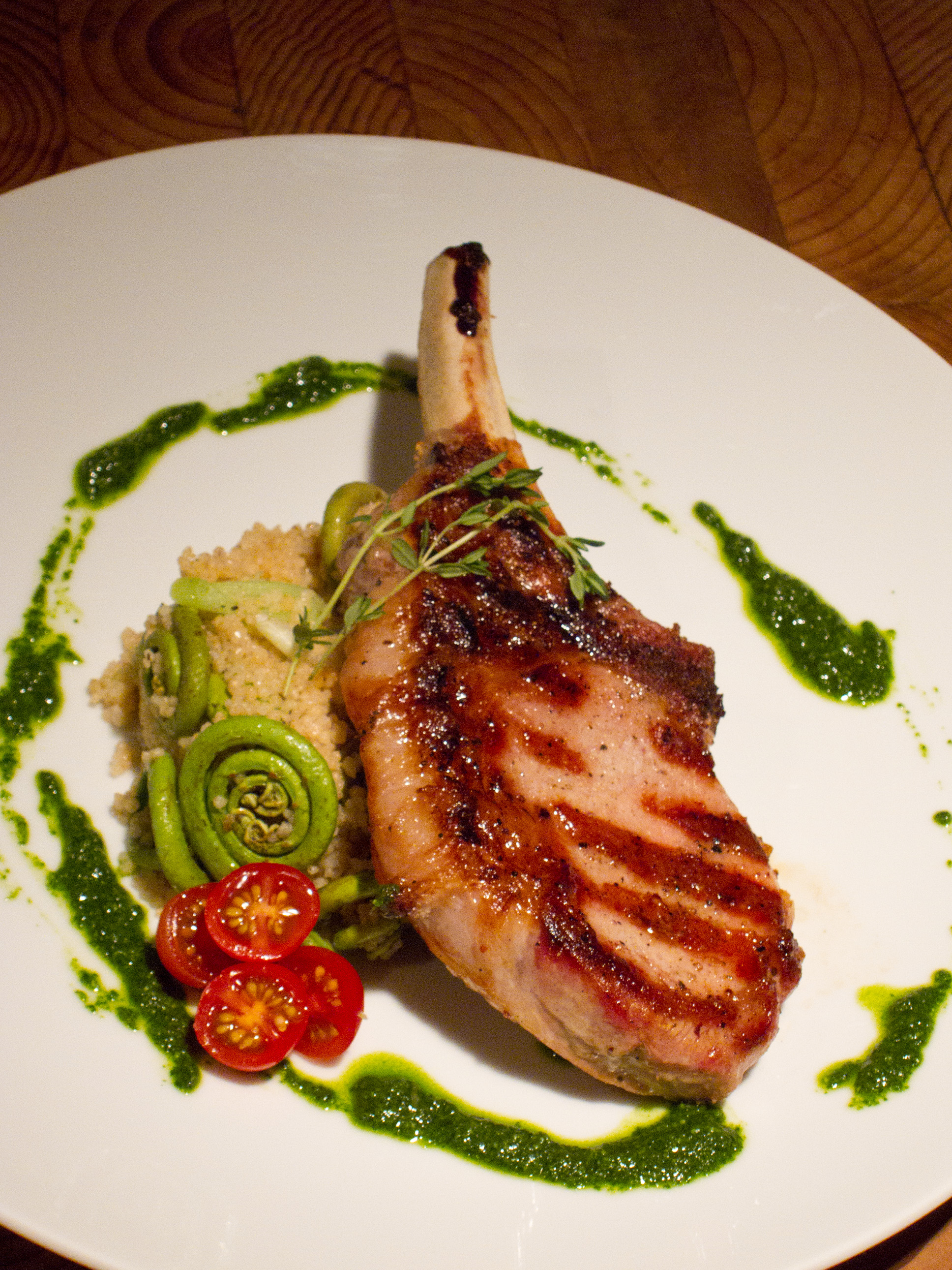 Grilled Pork with Fiddlehead Ferns, Spring Garlic Couscous and Nasturtium Pesto
