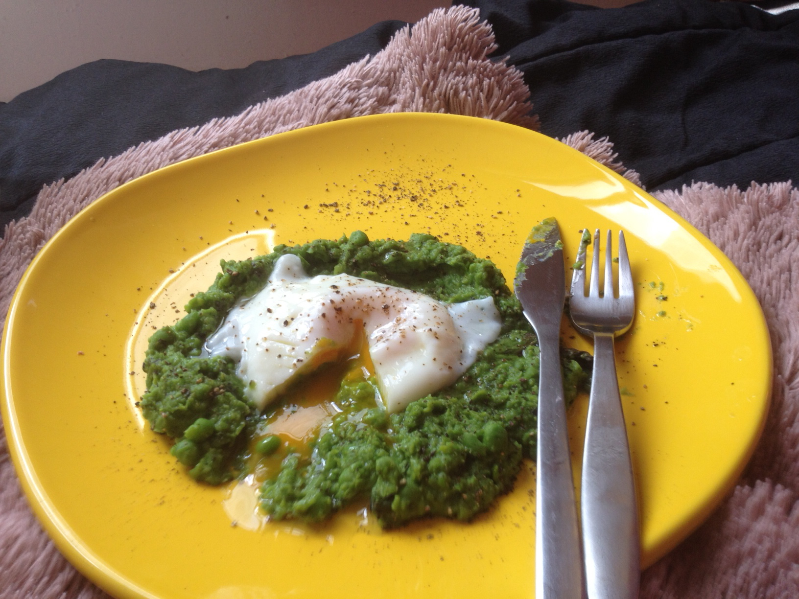 Poached egg on mint spring pea puree with truffle oil