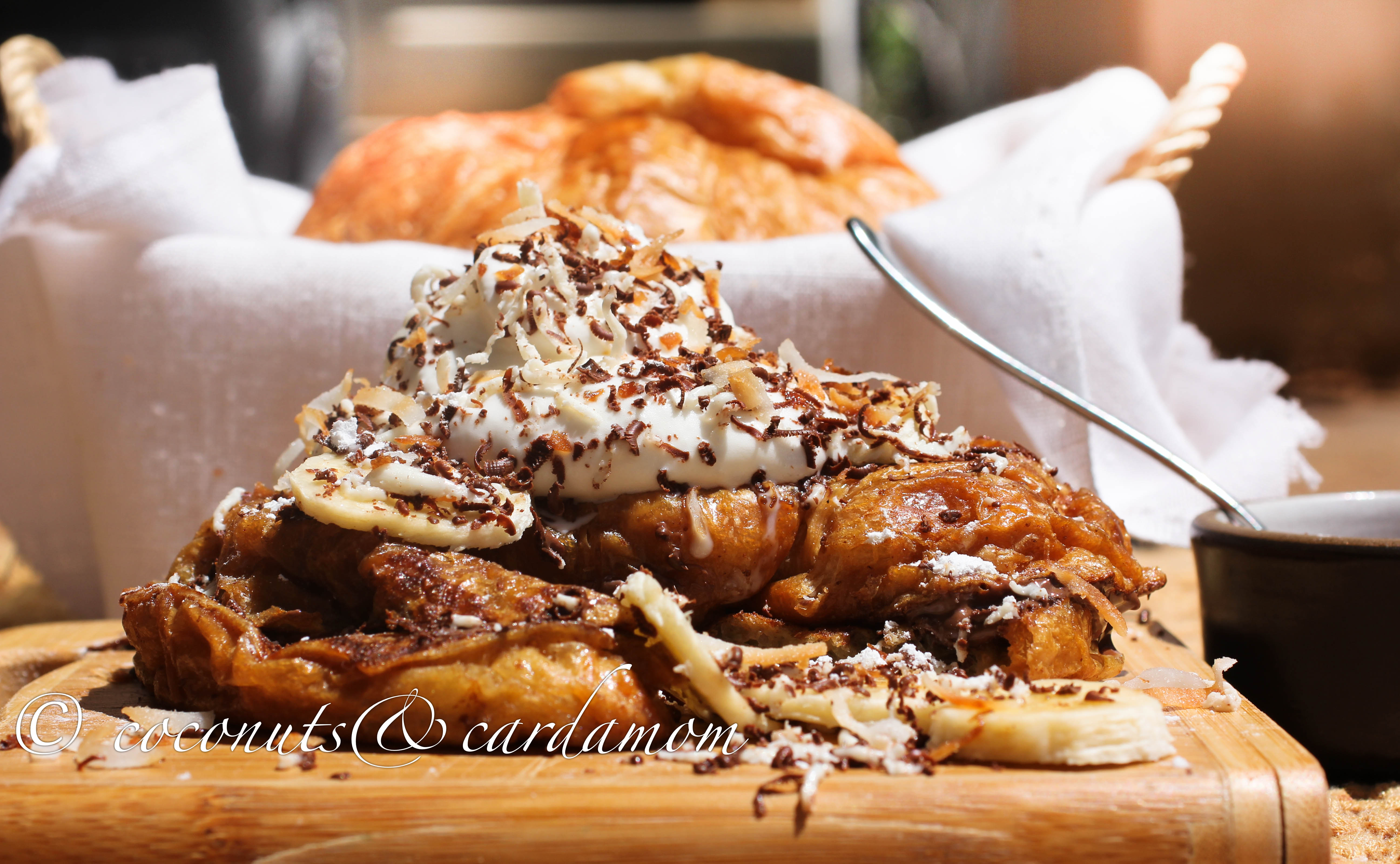Croissant French Toast Stuffed with Nutella and Topped with Coconut & Banana