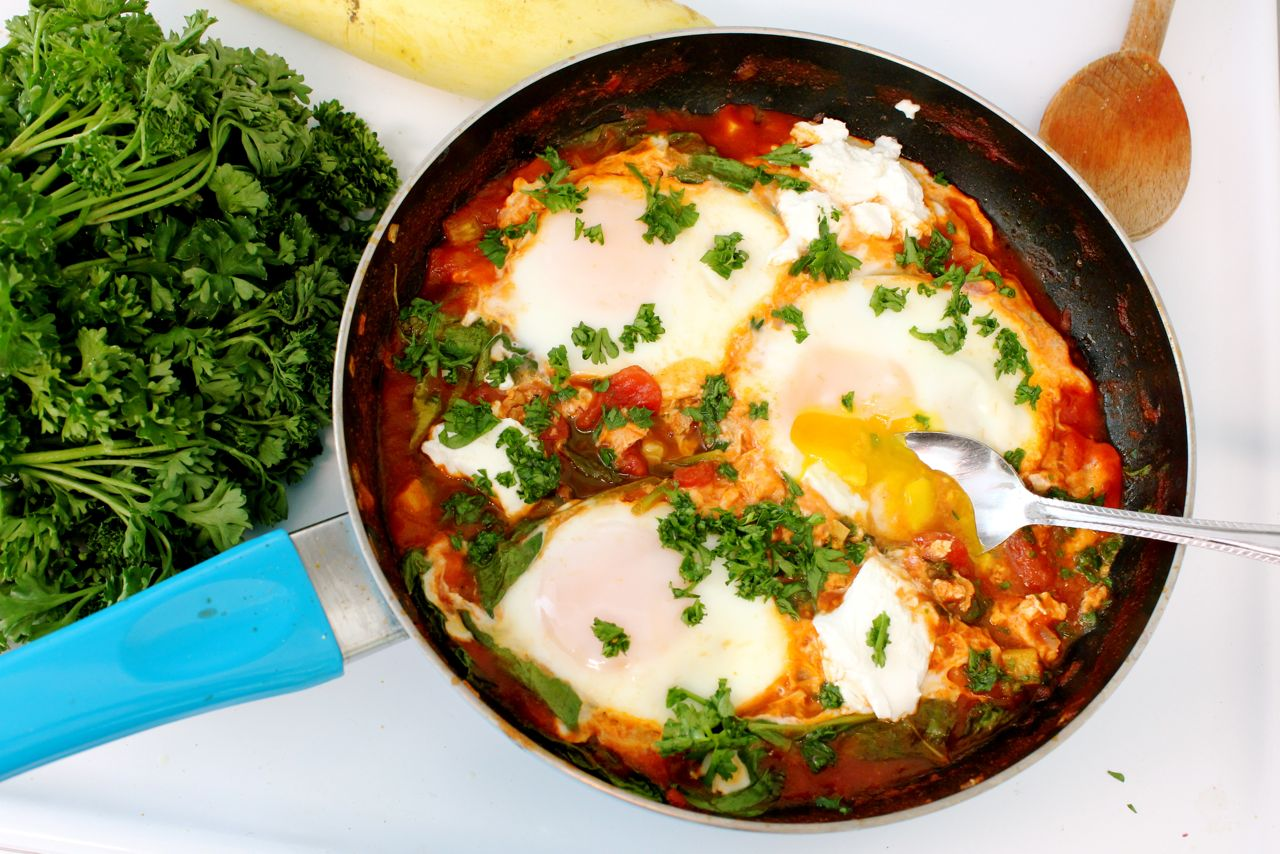 Shakshuka with Summer Squash, Spinach, and Goat Cheese