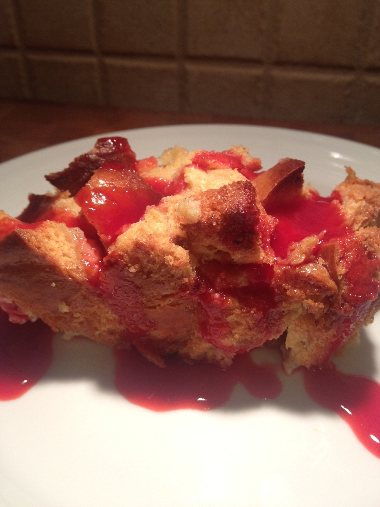 Gooey Mango Bread Pudding with Raspberry Sauce
