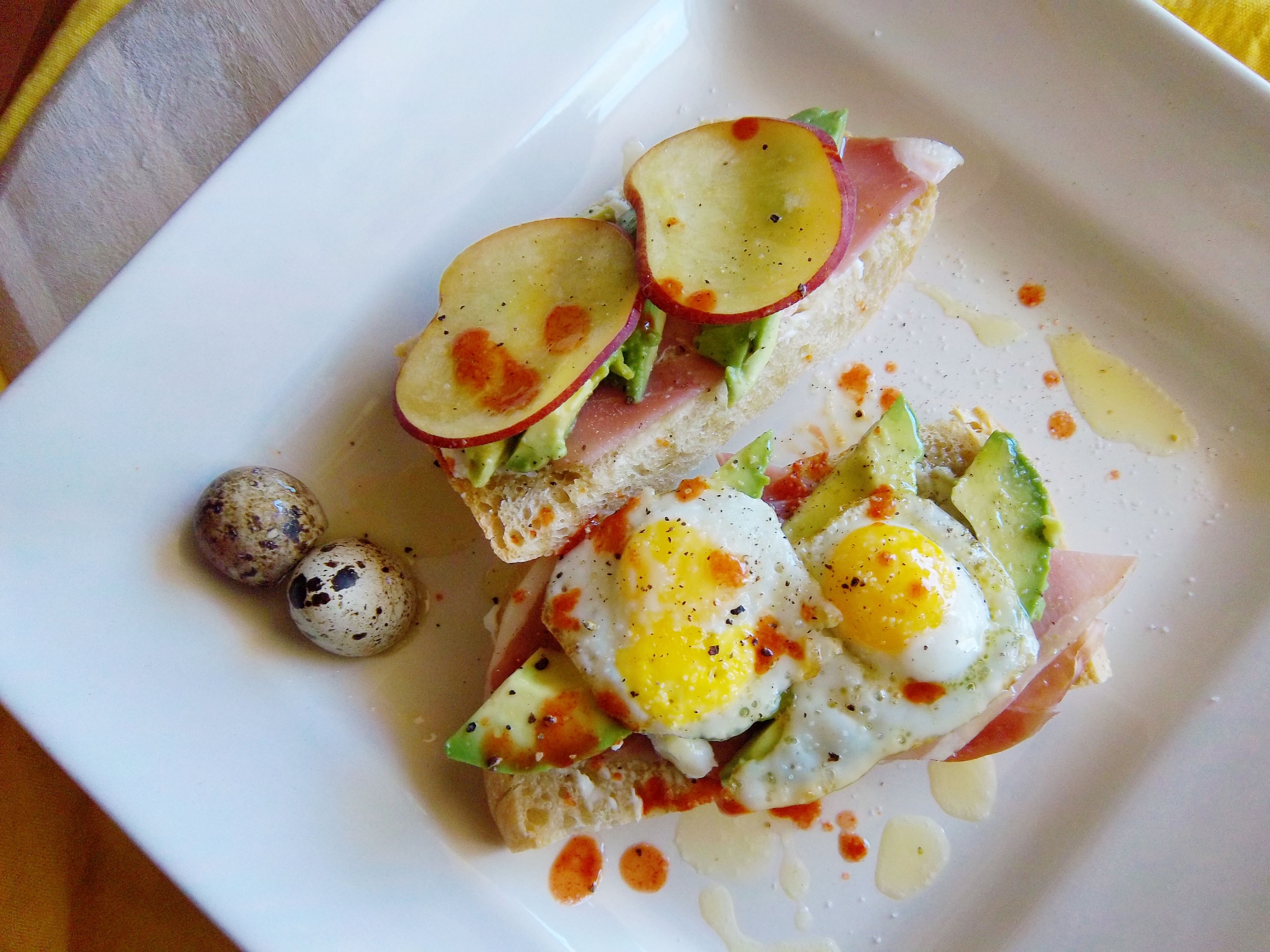 Avocado Tartine with Quail Eggs, Prosciutto & Goat Cheese