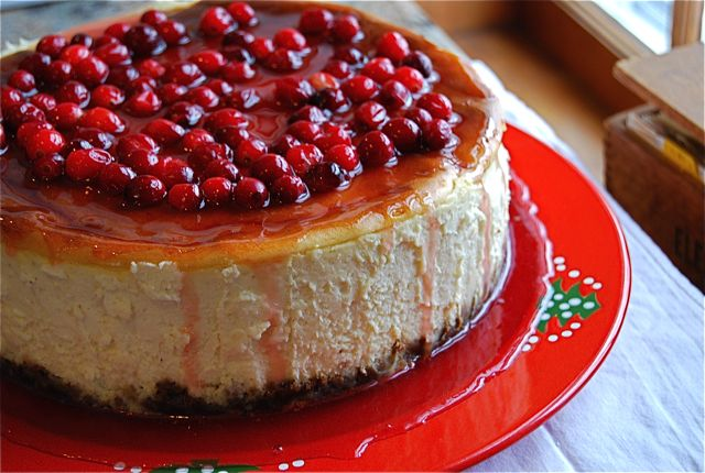 Eggnog Cheesecake with Gingersnap Crust & Pomegranate Glaze