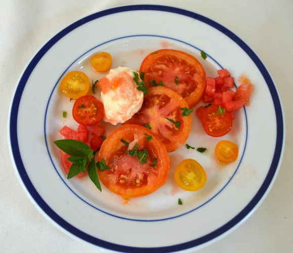 Heirloom tomato salad with fresh mozzarella, watermelon and mint