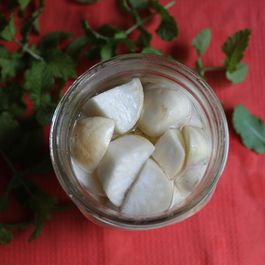 Finished_turnip_pickles_in_a_jar_surrounded_by_mint