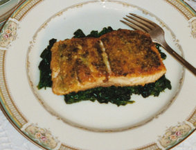 Falafel Crusted Salmon on a Bed of Spinach