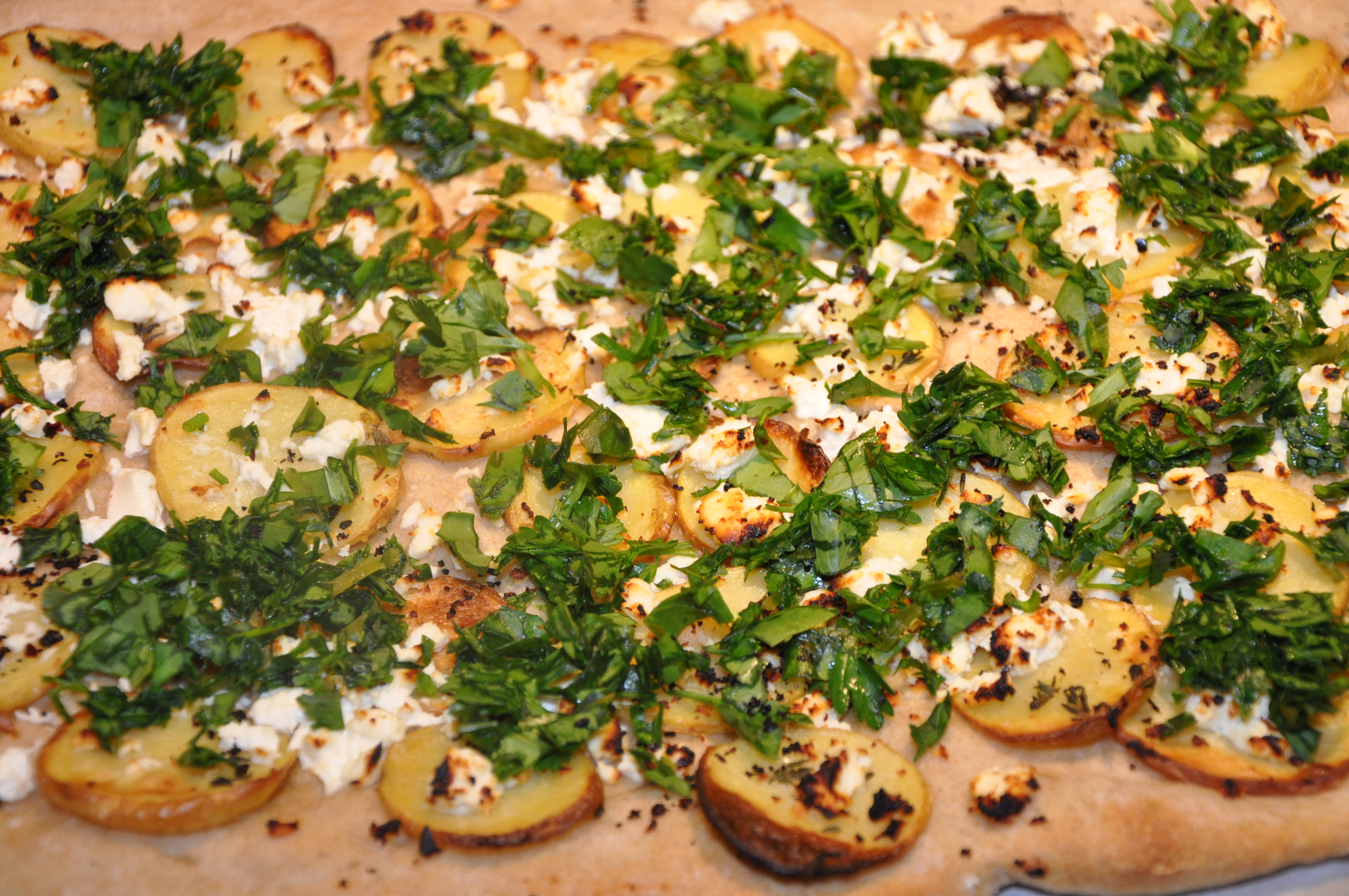 Roasted Potato Pizza with Goat Cheese, Spring Herbs and Urfa Biber