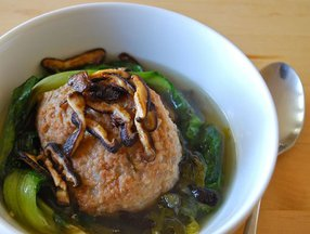 Stewed pork meatballs and escarole with crisped shiitakes