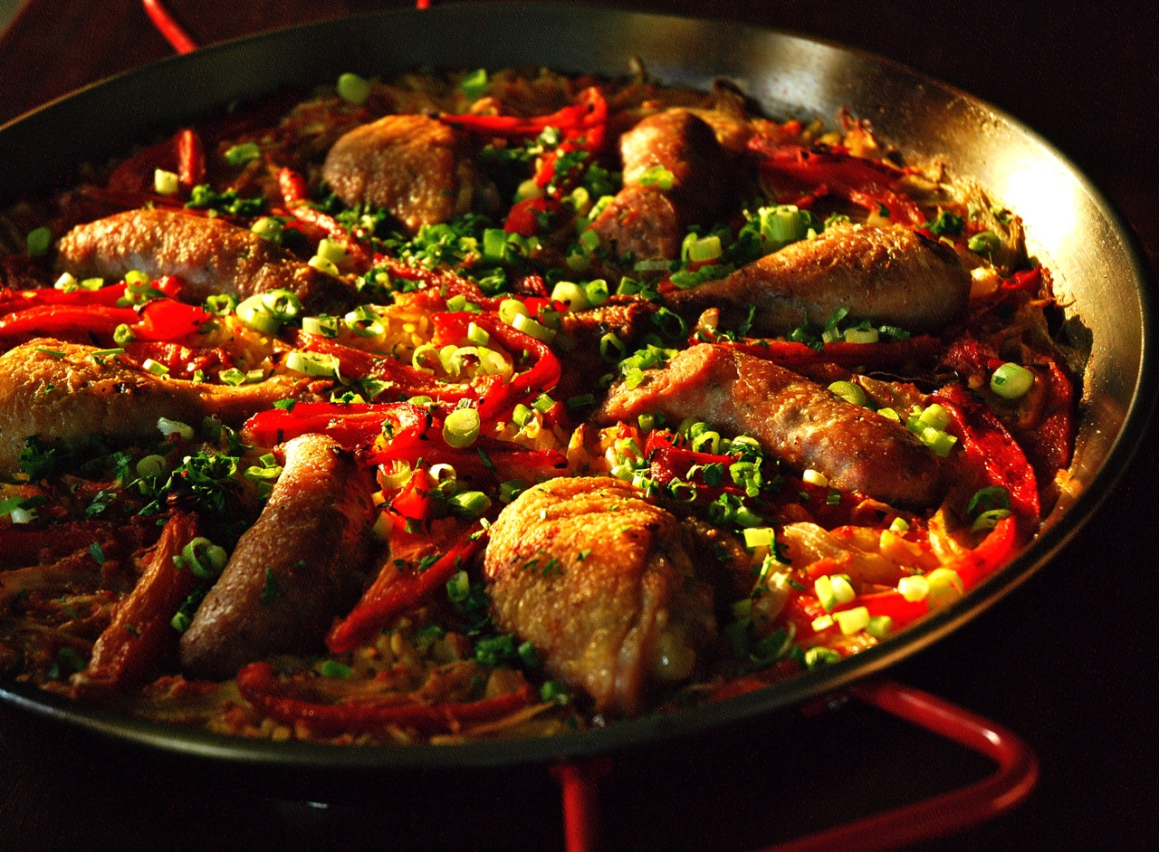 Spanish Paella with chicken, sausage, and red pepper.