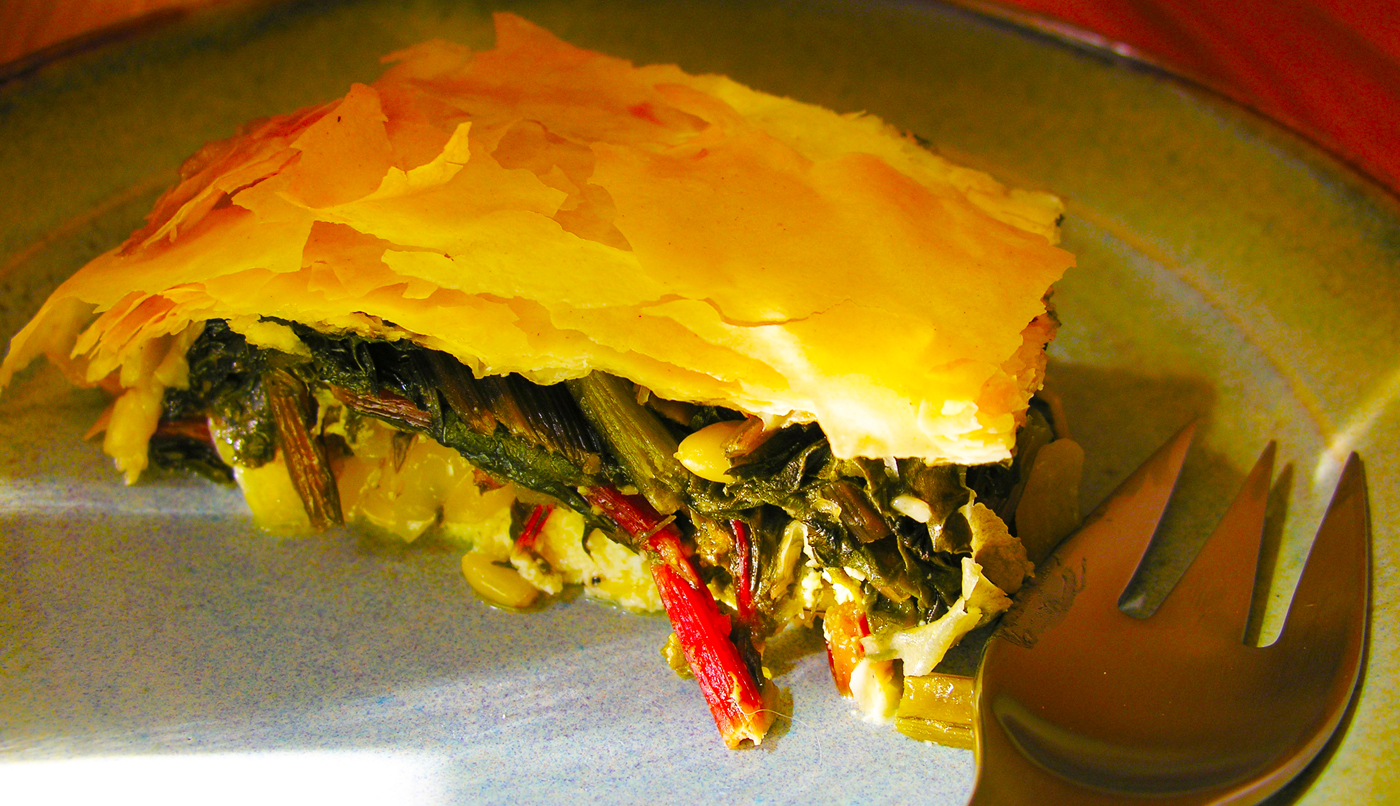 Harvest pie with swiss chard, cheese, orange zest and fennel