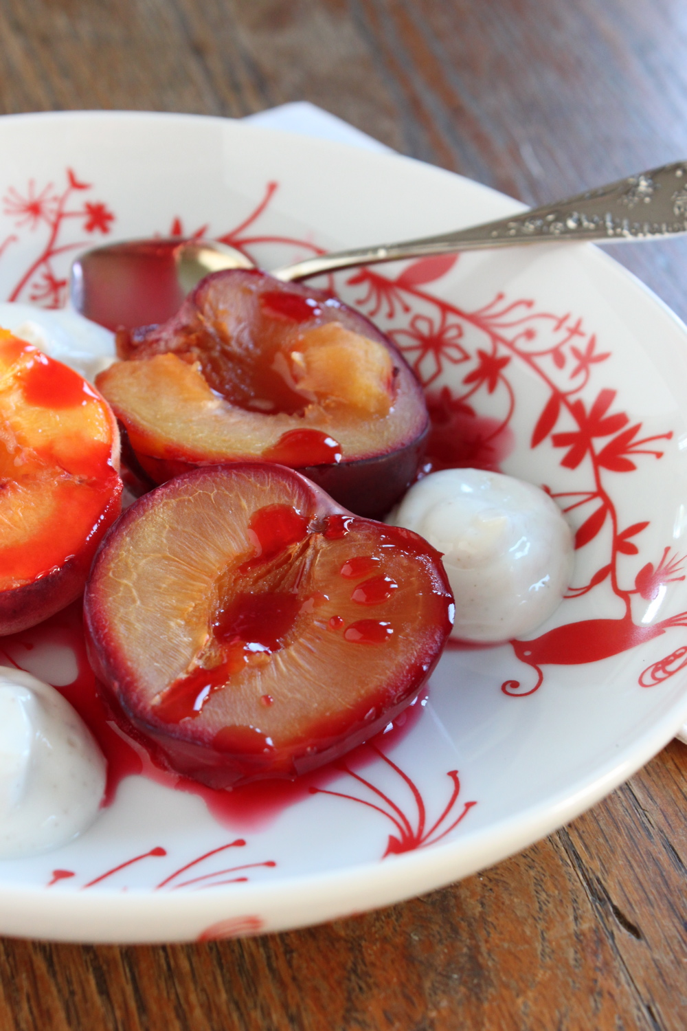 Roasted plums with bay leaf creme anglaise