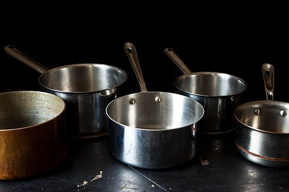 Lined_up_saucepans