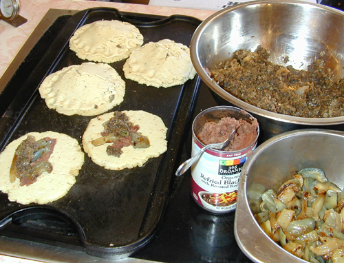 Pupusas stuffed with sauted mushrooms and pesto