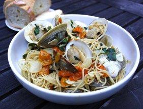 Joseph_fisheries_little_neck_clams_with_taliaferro_farms_sungold_tomatoes_basil_garlic_and_spaghetti