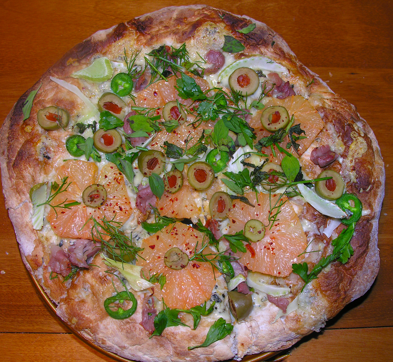 Pink grapefruit and green olive pizza