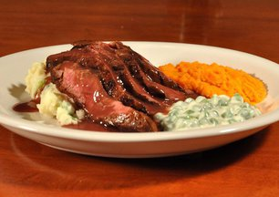Grilled_flat_iron_steak_with_carrot_puree