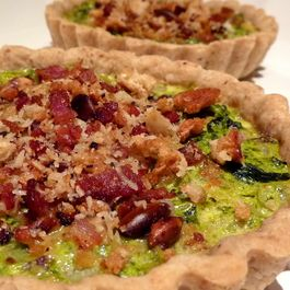 Kale and Kumquat Tarts with a Pancetta Streusel in a Toasted Pumpkin Seed Crust