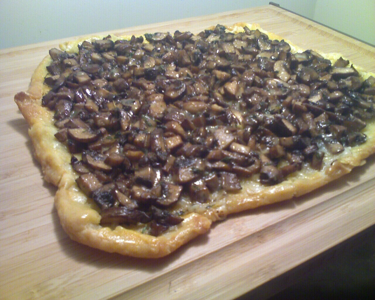 Mushroom Crostata with Roasted Garlic, Taleggio, and Thyme