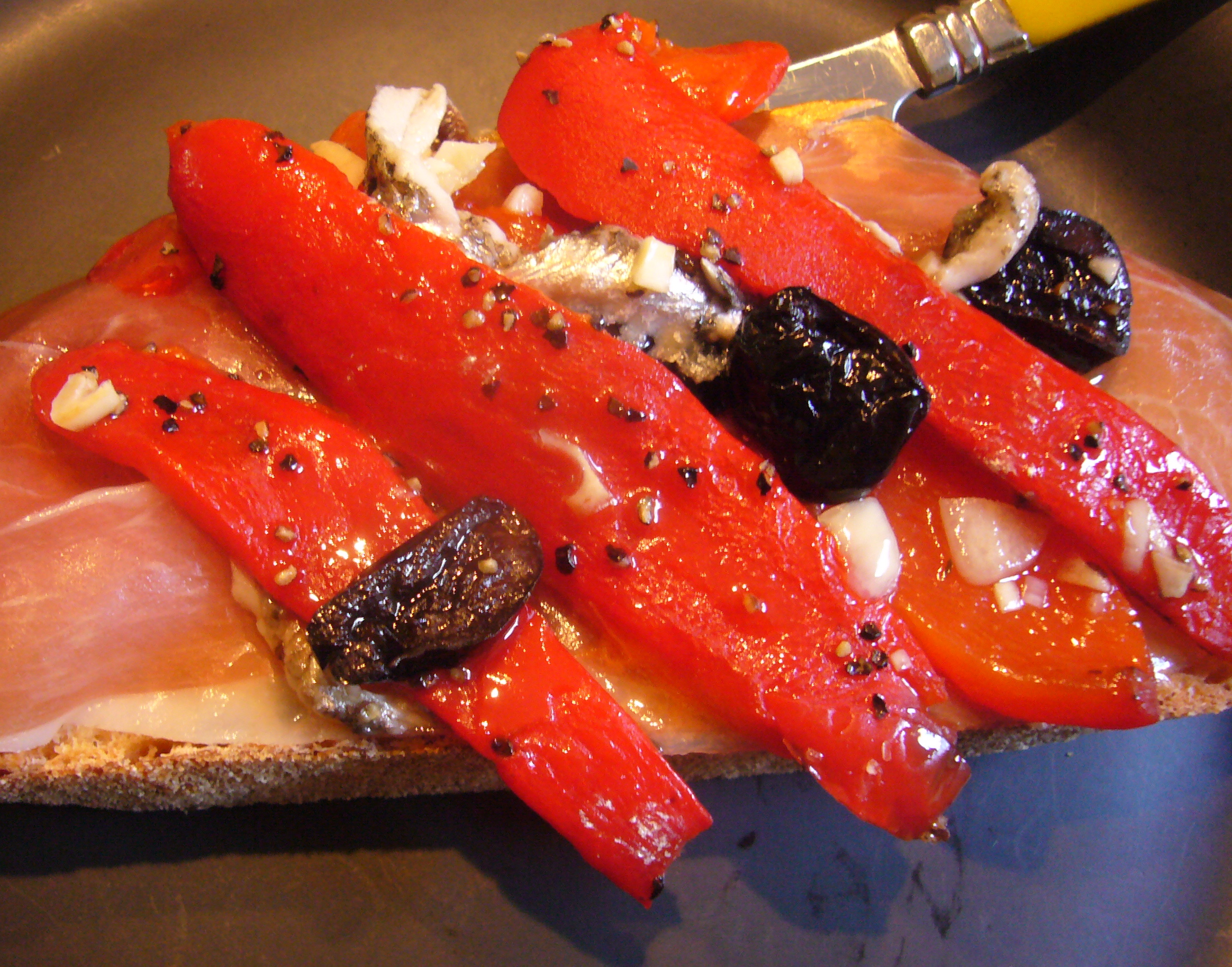Jamon Serrano with Marinated Red Peppers and Boquerones