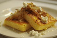 Griddled Polenta Cakes with Caramelized Onions, Goat Cheese, and Honey