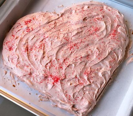 Champagne raspberry heart shaped cake with cream cheese brown sugar frosting