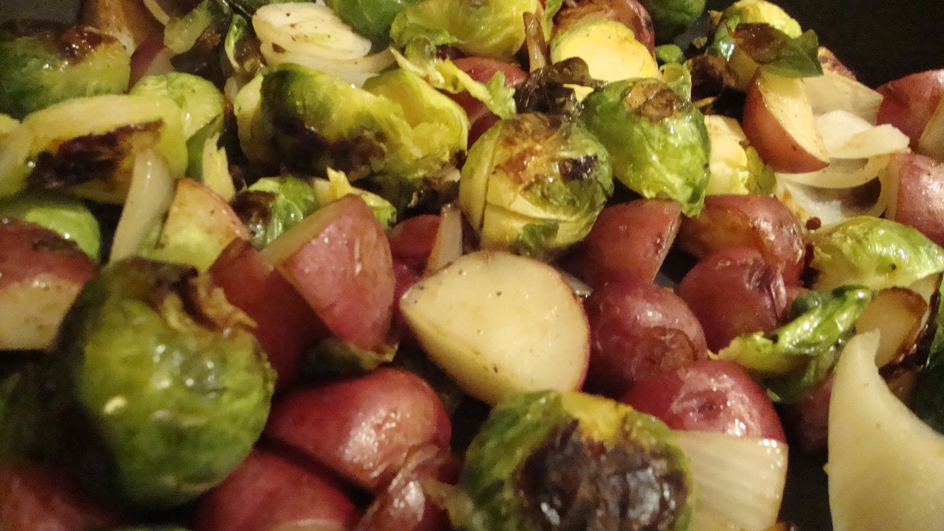 Pan-Roasted Brussels Sprouts with New Potatoes, Onions, and Crispy Parmesan