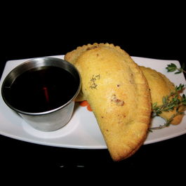 Caramelized Pear and Bacon Empanadas with Thyme Maple Syrup