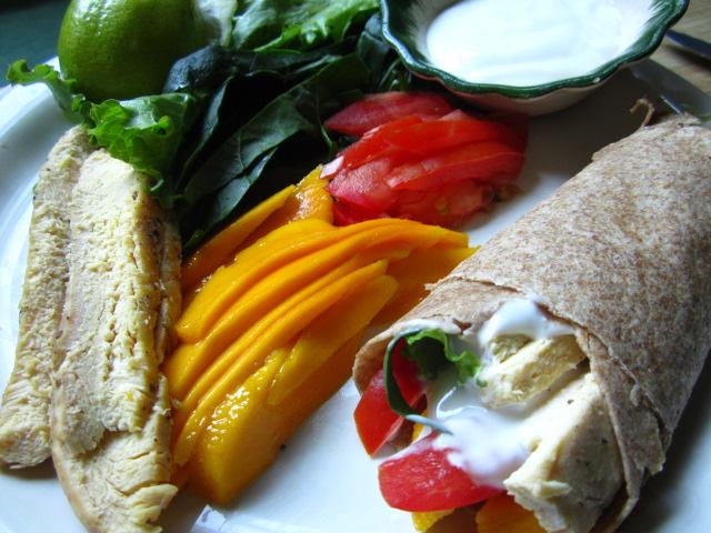 wholewheat chicken mango wrap with lime yogurt sauce.