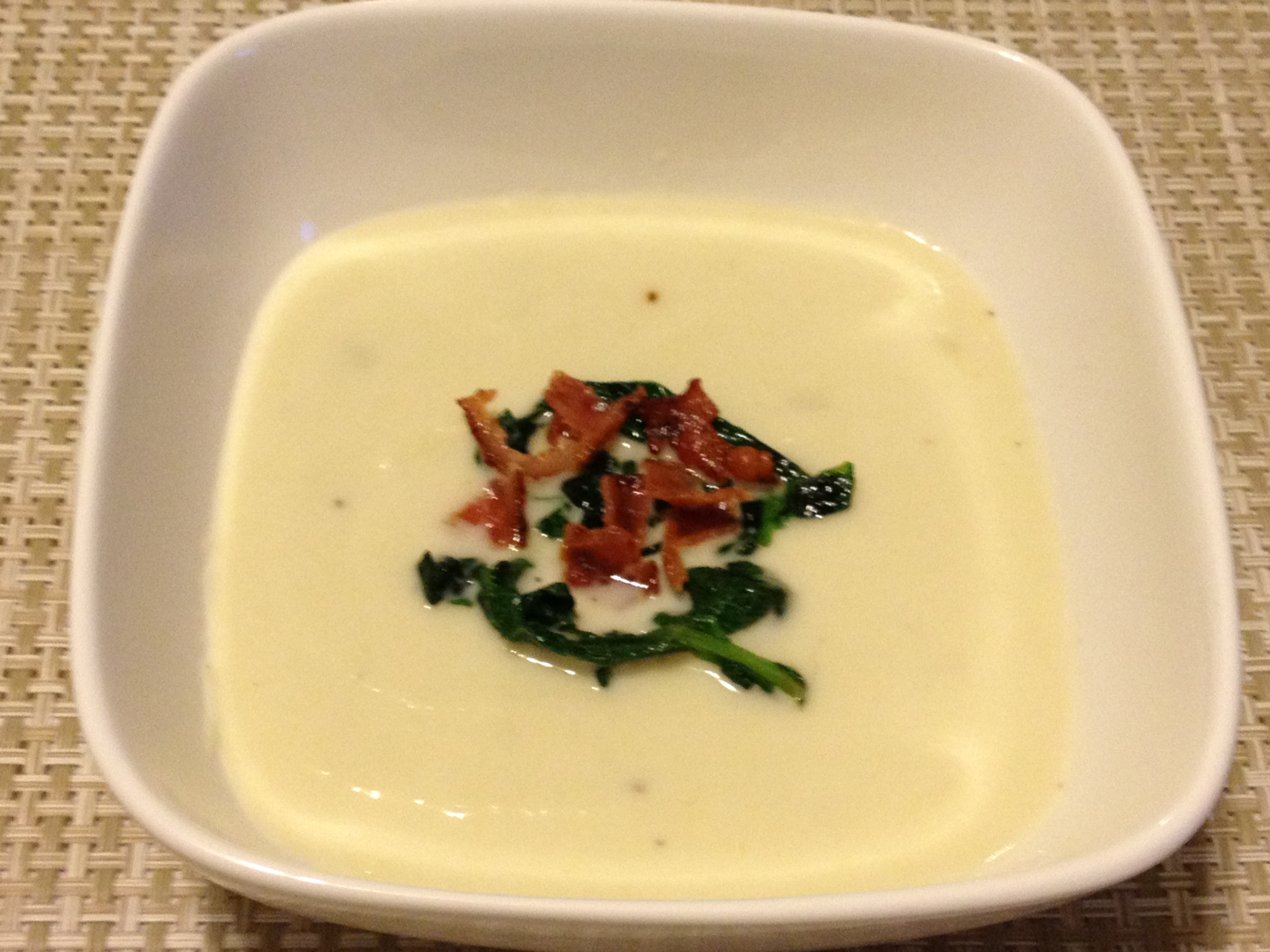 Creamy Spring Turnip Soup With Wilted Radish Greens And Bacon