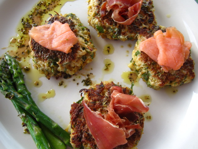 Cauliflower fritters with smoked salmon, prosciutto herbed dressing.