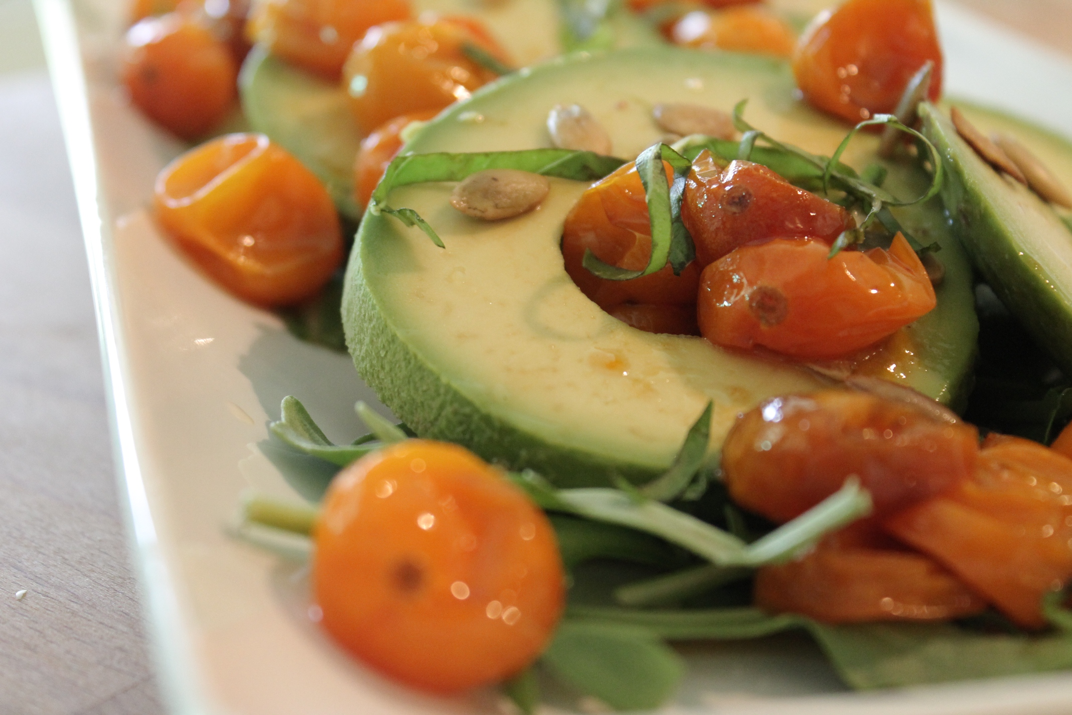 avocado with pomegranate molasses tomatoes, citrus, and basil.