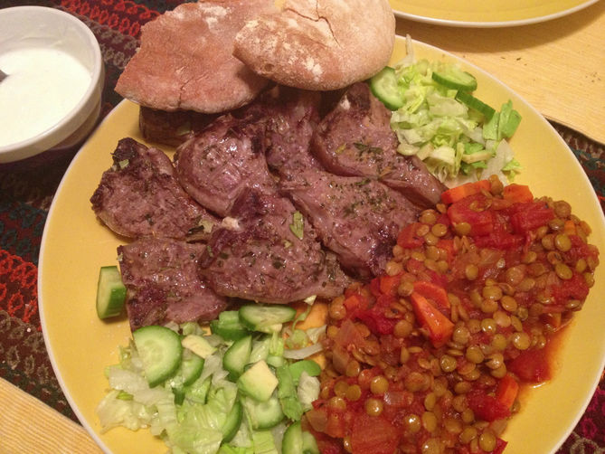 Lamb loin chops with lentils in the tomato sauce