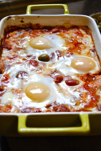 Baked Feta with Olives, Tomatoes, and Eggs