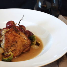 Crispy Braised Chicken Thighs with Grapes & Pearl Onions by DragonFly