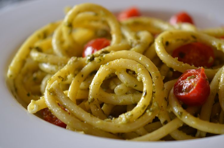 Bucatini with pesto and cherry tomatoes