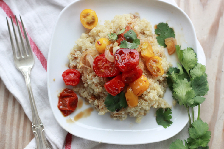 roasted cherry tomatoes + pomegranate molasses over quinoa